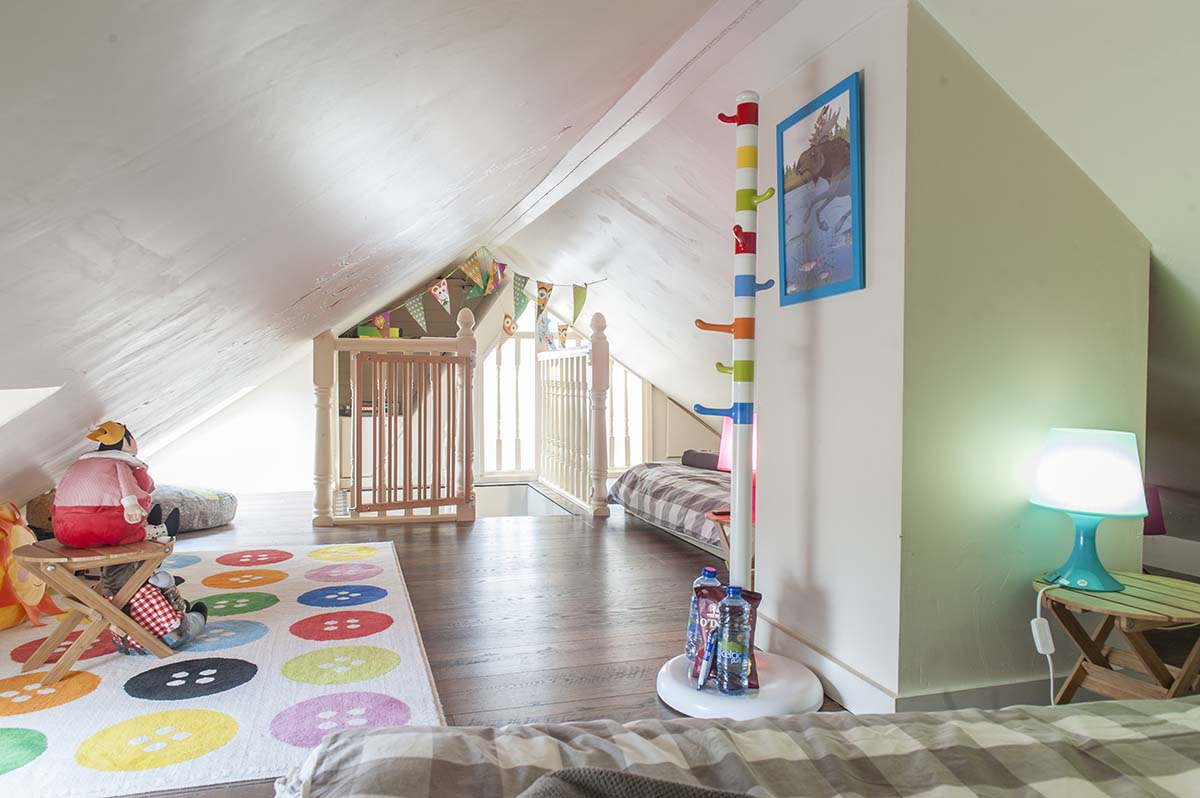 Light and airy, this loft space will make the children smile.